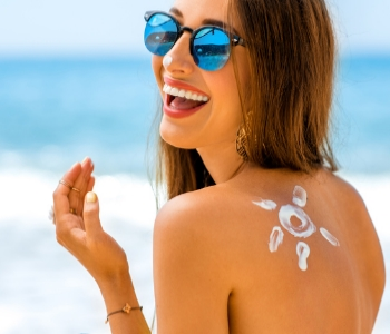woman at the beach smiling and happy