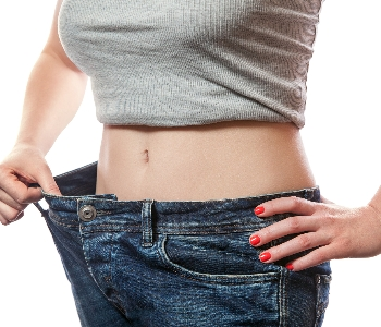 woman trying out trousers been worn before coolsculpting fat reduction treatment and its bigger