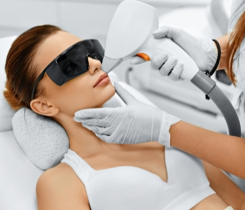 Woman getting leaser hair removal treatment