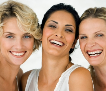 Middle aged women smile with musch younger looking skin after treatment