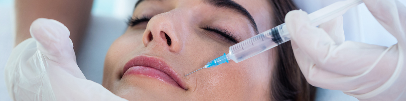 Woman having injection treatment